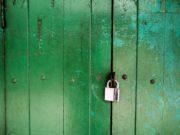 padlock on green door